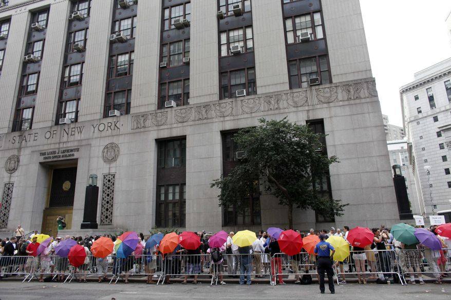 Same-sex couples wait in line to receive marriage licenses at the Manhattan City Clerk's office on July 24, 2011. (Associated Press) **FILE**