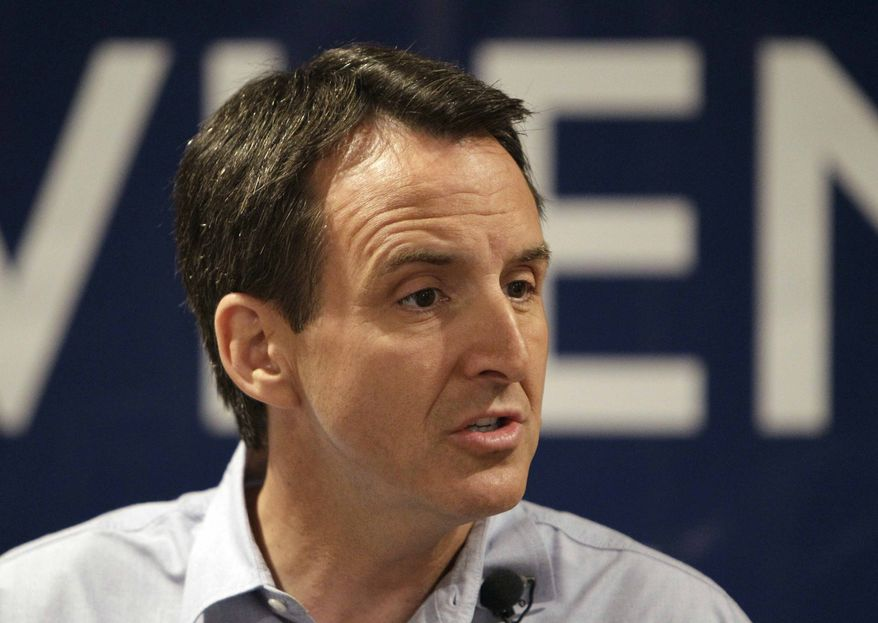Former Minnesota Governor Tim Pawlenty speaks to local residents at The Sports Page bar & grill, Wednesday, July 20, 2011, in Indianola, Iowa. (AP Photo/Charlie Neibergall) ** FILE **