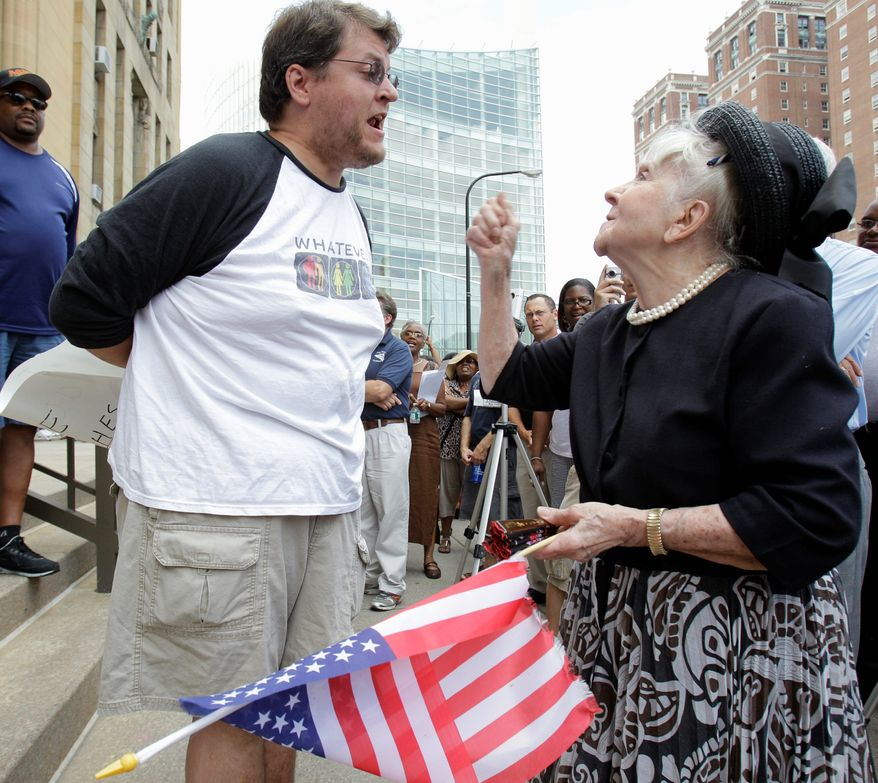 Gay marriage supporter Dan McKowan, left, argues with gay marriage protestor Maria Murphy during a rally at City Hall in Buffalo, N.Y., Sunday, July 24, 2011. (AP Photo/David Duprey)