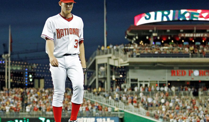 ASSOCIATED PRESS Stephen Strasburg taking the mound at Nationals Park in 2010 meant on averate an additional 15,564 fans through the turnstiles. Strasburg has been shelved by an elbow injury this year. Below, the Thomas Jefferson mascot gave a warm welcome on Opening Day.