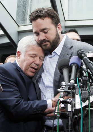 ASSOCIATED PRESS New England Patriots owner Robert Kraft is hugged by Indianapolis Colts center Jeff Saturday after the lockout officially was lifted.