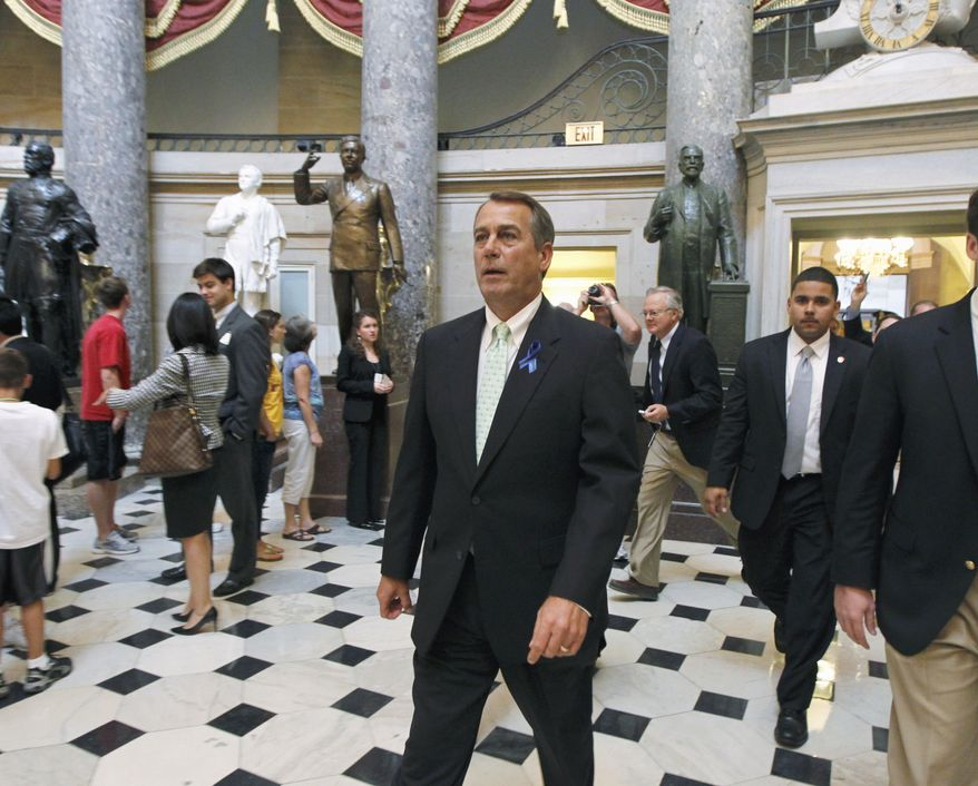 As Congressional leaders try to reach an accord to avert a debt-ceiling crisis, House Speaker John Boehner, Ohio Republican, walks from his office to the House Chamber on Capitol Hill on July 25, 2011, following a morning meeting with other GOP leaders. (Associated Press)