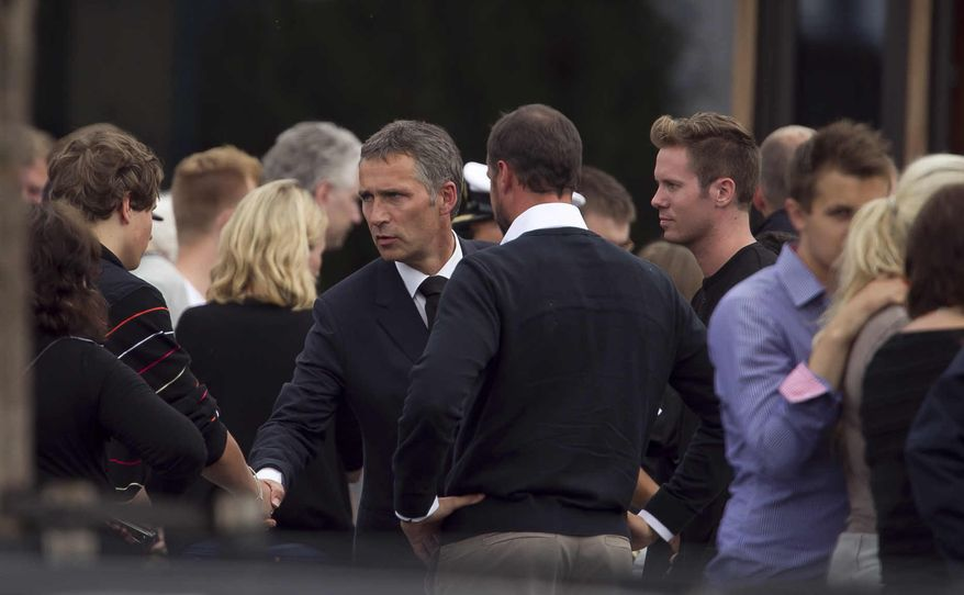 Norway's Prime Minister Jens Stoltenberg (center) talks at a hotel in Sundvolden, Norway, with survivors and grieving relatives of the victims of a horrific killing spree on an idyllic island retreat. (Associated Press)