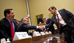 """House Oversight and Government Reform Committee Chairman Rep. Darrell E. Issa, California Republican (right), greets Lorren Leadmon, an ATF intelligence operations specialist, before the hearing Tuesday about the fallout from """"Operation Fast and Furious."""" At left is Carlos Canino, ATF acting attache to Mexico."""