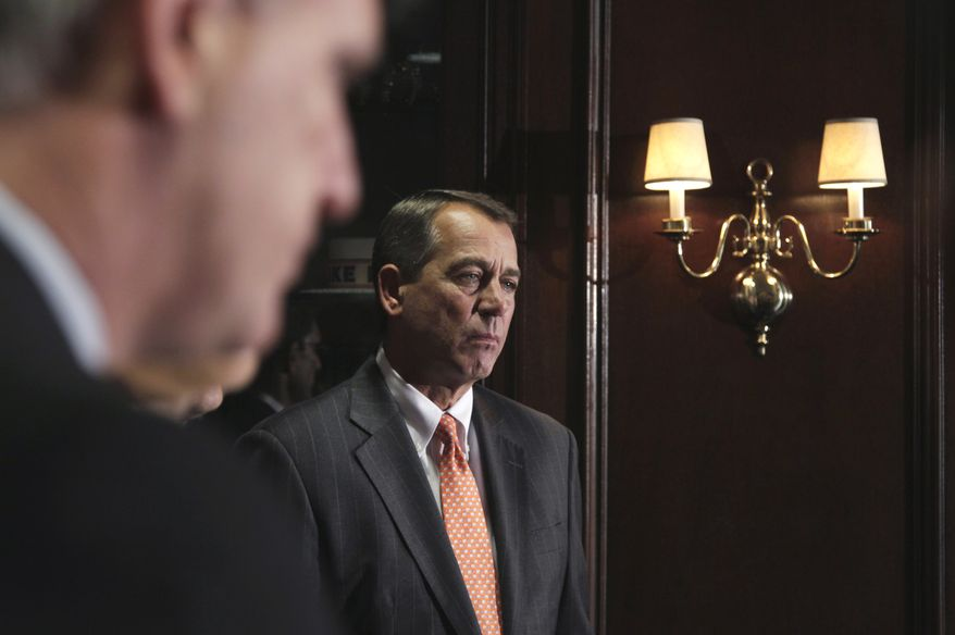 House Speaker John Boehner, Ohio Republican, listens during a news conference on July 26, 2011, at the Republican National Committee on Capitol Hill. (Associated Press)