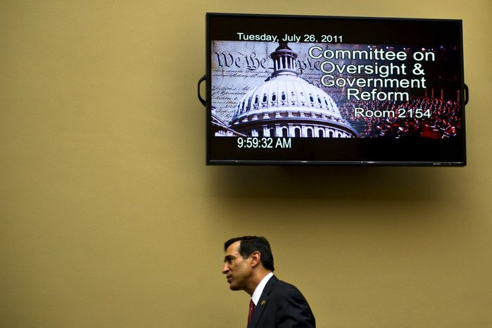 Committee Chairman Rep. Darrell Issa, R-Calif., arrives to a House Oversight and Government Reform hearing looking into the Justice Department's firearms trafficking investigation, Operation Fast and Furious, on Capitol Hill Washington, D.C., Tuesday, July 26, 2011. (Drew Angerer/The Washington Times)