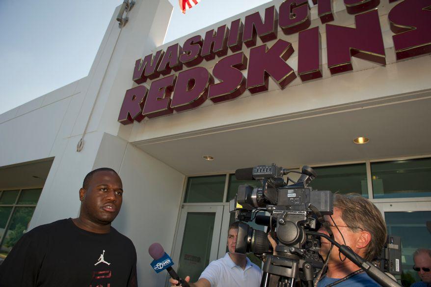 Washington Redskins defensive end Jeremy Jarmon offers remarks to reporters outside the Redskins offices, as some of the Washington Redskins players arrive at Redskins Park in Ashburn, Va., Tuesday, July 26, 2011, a day after the NFL lockout came to an end. (Rod Lamkey Jr./The Washington Times)