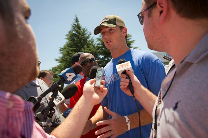 Washington Redskins quarterback John Beck talks to reporters as he and some of the Washington Redskins players return to Redskins Park in Ashburn, Va., Tuesday, July 26, 2011, a day after the NFL lockout came to an end. (Rod Lamkey Jr./The Washington Times)