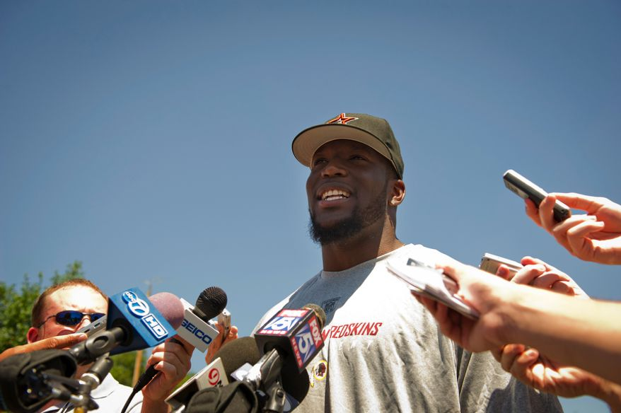 Washington Redskins linebacker Brian Orakpo talks to reporters as he and some of the other Washington Redskins players arrive at Redskins Park in Ashburn, Va., Tuesday, July 26, 2011, a day after the NFL lockout came to an end. (Rod Lamkey Jr./The Washington Times)