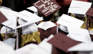 ** FILE ** Graduates listen to the commencement address at Kalamazoo Central High School in Kalamazoo, Mich., in June 2011. (Associated Press)