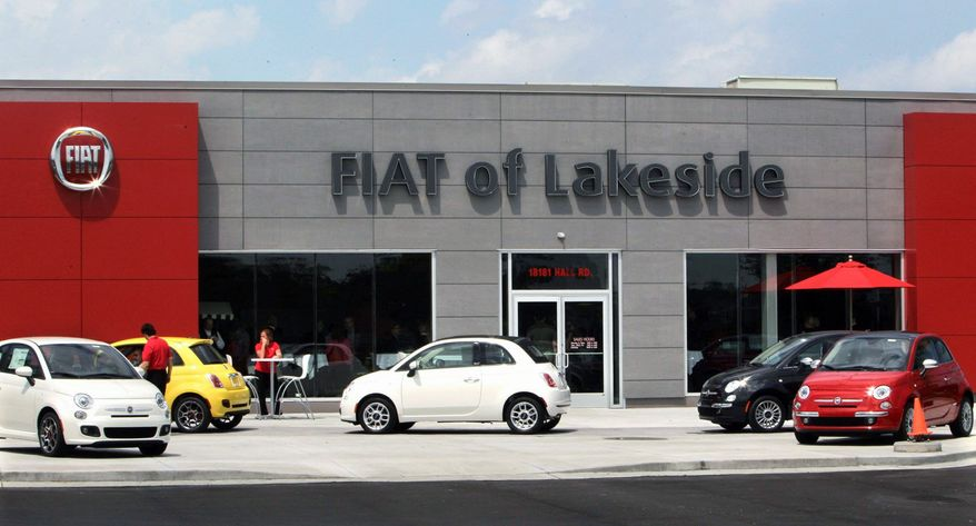 Fiat's chic but affordable 500 model (above, at a dealership in Michigan) will get its U.S. launch soon. The company, now the majority shareholder in Chrysler, plans to open 130 dealerships across the country in the next year in an appeal to both Euro flair and home-spun frugality. (Associated Press)