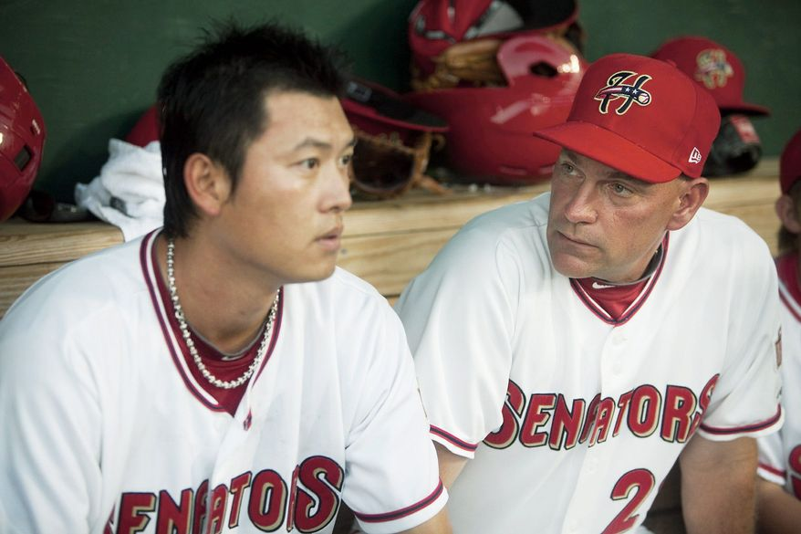 Chien-Ming Wang, (left), shown with Class AA Harrisburg pitching coach Randy Tomlin, on Friday will make his first major league start since having shoulder surgery in 2009. He's made six minor league starts (below) during the past month to prepare for the occasion. (Jenny Kane/The (Harrisburg, Pa.) Patriot-News)