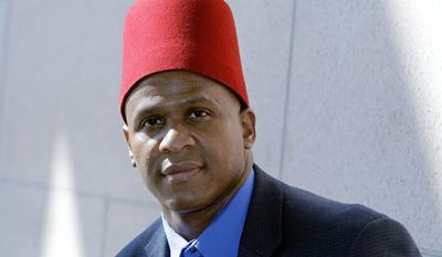 """Christopher Bennett-Bey, grand sheik of the Charlotte, N.C., temple of the Moorish Science Temple of America sect, says """"it's just distressing"""" that flimflam artists are using his organization as a false front for their illegal activities in the state and elsewhere across the country. (Associated Press)"""