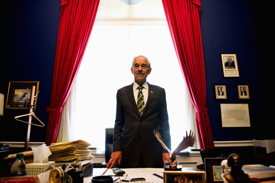 """Rep. Ron Paul, seen here in his Capitol Hill office, says the two major parties have become one. """"Although the rhetoric might vary, they've been one party. ... regardless of what they claim they believe."""" (Drew Angerer/The Washington Times)"""
