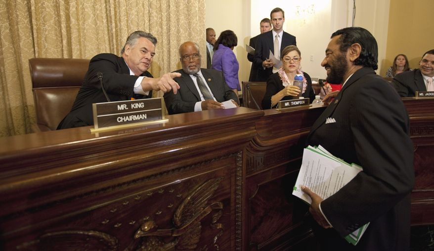 From left: House Homeland Security Committee Chairman Rep. Peter King, New York Democrat, speaks July 27, 2011, with committee members Rep. Bennie Thompson of Missouri, the committee's ranking Democrat; Rep. Loretta Sanchez, California Democrat; and Rep. Al Green, Texas Democrat, on Capitol Hill before the committee's hearing on Islamic radicalization in the U.S., focusing on recruitment within the Muslim American community. (Associated Press)