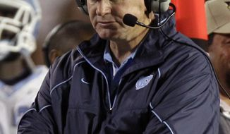 North Carolina has fired football coach Butch Davis. The school issued a statement Wednesday night announcing Davis' dismissal nine days before the start of preseason practice. (AP Photo/Alan Diaz, File)