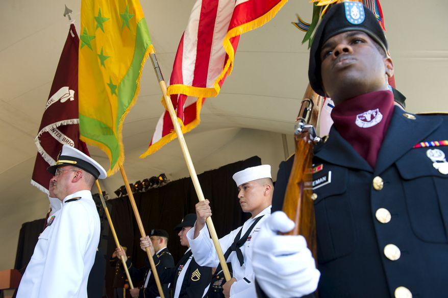 """Military representatives of the Army and Navy bring in the Walter Reed colors during a ceremony Wedesday, July 27, 2011 at Walter Reed Army Medical Center in Washington, D.C. These old colors were retired, or """"cased,"""" during the ceremony, marking the transition from the Washington, D.C., facility to facilities at Ft. Belvoir and Bethesda Naval Medical Center. (Barbara L. Salisbury/The Washington Times)"""