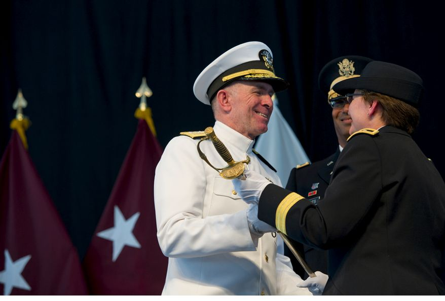 RADM Matthew Nathan, U.S. Navy, smiles as he exchanges words with U.S. Army MG Carla Hawley-Bowland while she hands him the Major Walter Reed's Sword during a ceremony Wednesday, July 27, 2011 at Walter Reed Army Medical Center in Washington, D.C. The handing over of the sword officially marks the transition from the Washington, D.C., facility to Bethesda Naval Medical Center and Ft. Belvoir. (Barbara L. Salisbury/The Washington Times)