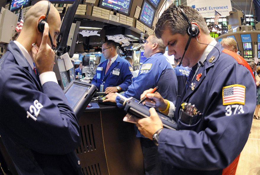 In this July 26, 2011, photo, traders work on the floor of the New York Stock Exchange, in New York. Global stocks were weighed down again on Wednesday, July 27, by worries that the U.S. could default on its debt or see its credit rating cut as lawmakers in the world's largest economy appear no nearer to agreeing on raising the borrowing limit. (AP Photo/Henny Ray Abrams)