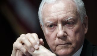 """Sen. Orrin G. Hatch, Utah Republican, said of a new Centers for Medicare and Medicaid Services report, """"Simply put, this report states the obvious, that Americans have known for more than a year - the $2.6 trillion law only makes the fundamental problem of skyrocketing health care costs worse."""" (Associated Press)"""
