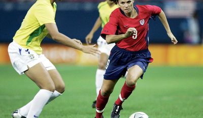 Mia Hamm's brother Garrett died from a rare blood disorder less than a year after she won a gold medal in the 1996 Atlanta Olympics. His battle inspired the creation of the Mia Hamm Foundation and its largest annual charity event, the Celebrity Soccer Challenge. (Associated Press)