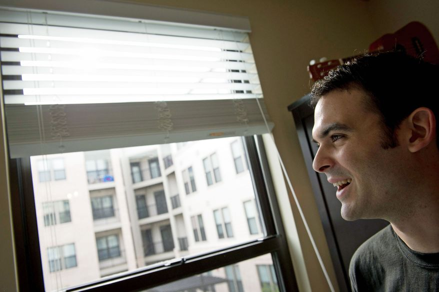 "PHOTOGRAPHS BY ROD LAMKEY JR./THE WASHINGTON TIMES  Mr. McLaughlin, looking out the living-room window of the apartment he shares with Ms. Harbin, says an experience living alone in Japan, where he didn't speak the language, was like ""living in a bubble"" and made him depressed."