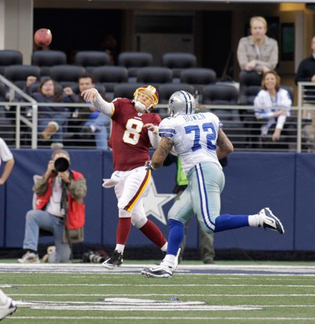 ASSOCIATED PRESS PHOTOGRAPHS Defensive end Stephen Bowen is shown putting the heat on Redskins quarterback Rex Grossman. Bowen signed a five-year, $27 million deal. Barry Cofield (below left), a starter for the New York