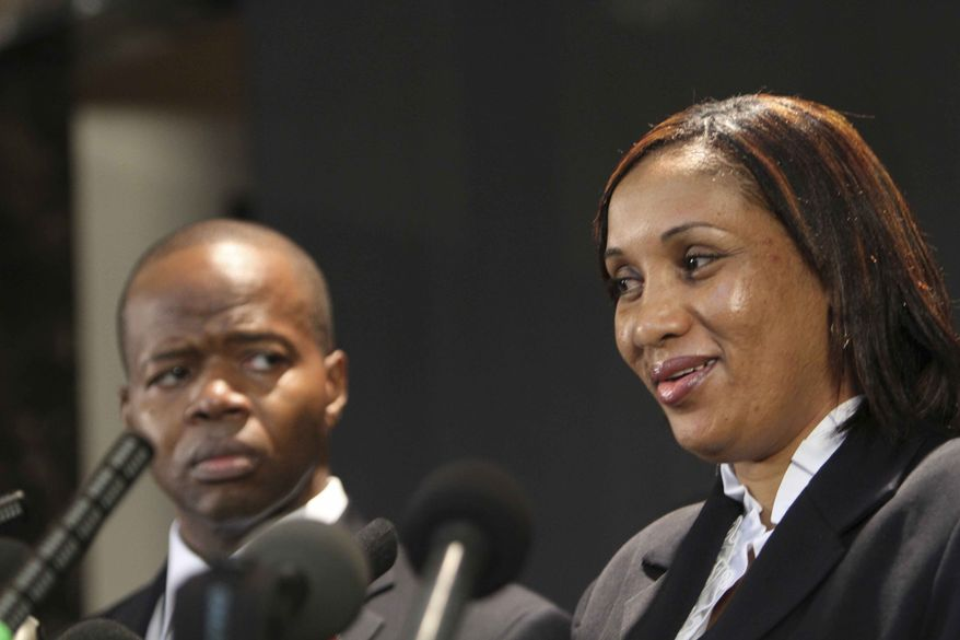 Nafissatou Diallo, who accused former IMF Head Dominique Strauss-Kahn of sexually attacking her, speaks to reporters as her attorney Ken Thompson listens during a news conference Thursday, July 28, 2011, the Christian Cultural Center in the Brooklyn borough of New York. (AP Photo/Mary Altaffer)