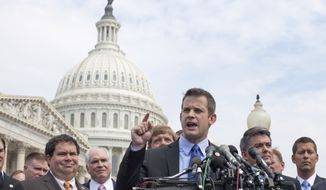 ** FILE ** Rep. Adam Kinzinger (at podium), Illinois Republican, speaks during a July 28, 2011, news conference on Capitol Hill to announce he will vote yes on the GOP plan to raise the debt limit. He is joined by Reps. Blake Farenthold (second from left), Texas Republican; Cory Gardner (second from right), Colorado Republican; and Sean Duffy (right), Wisconsin Republican. (Associated Press)