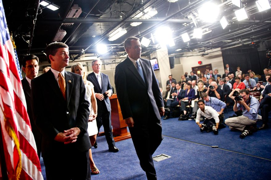 House Speaker John Boehner and GOP leadership leave a press conference after discussing the debt bill in Washington, D.C., Thursday, July 28, 2011. (Drew Angerer/The Washington Times)