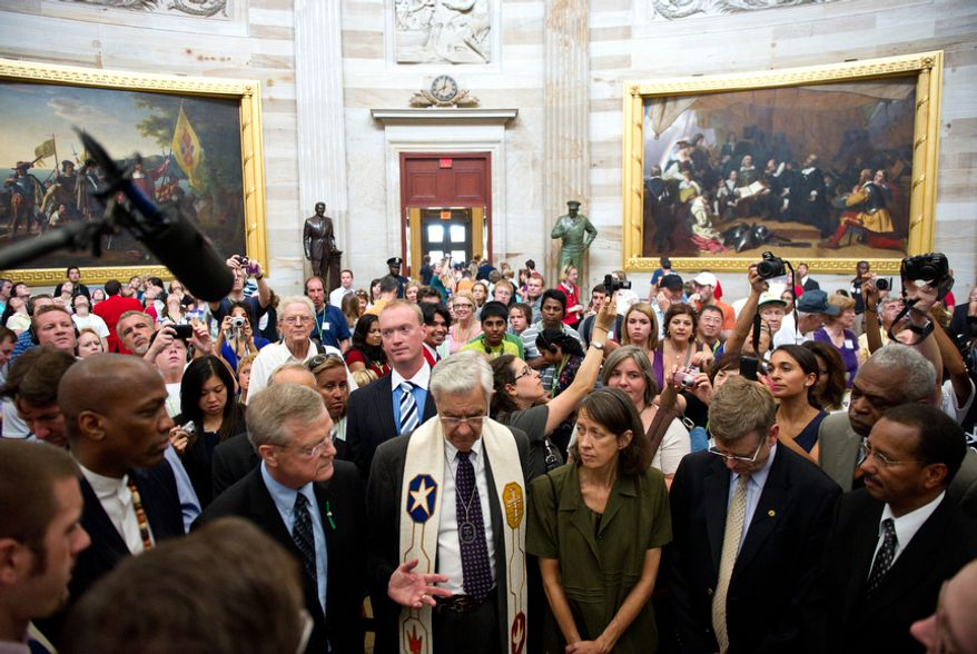 "Calling themselves an ""Interfaith Coalition,"" a group of religious leaders leads prayer and protest against Congressional leaders in the Capitol Rotunda, on Capitol Hill, in Washington, D.C., Thursday, July 28, 2011. The group said they were against ""immoral budget cuts"" and said they felt poor people were not being protected by new budget decisions. (Drew Angerer/The Washington Times)"