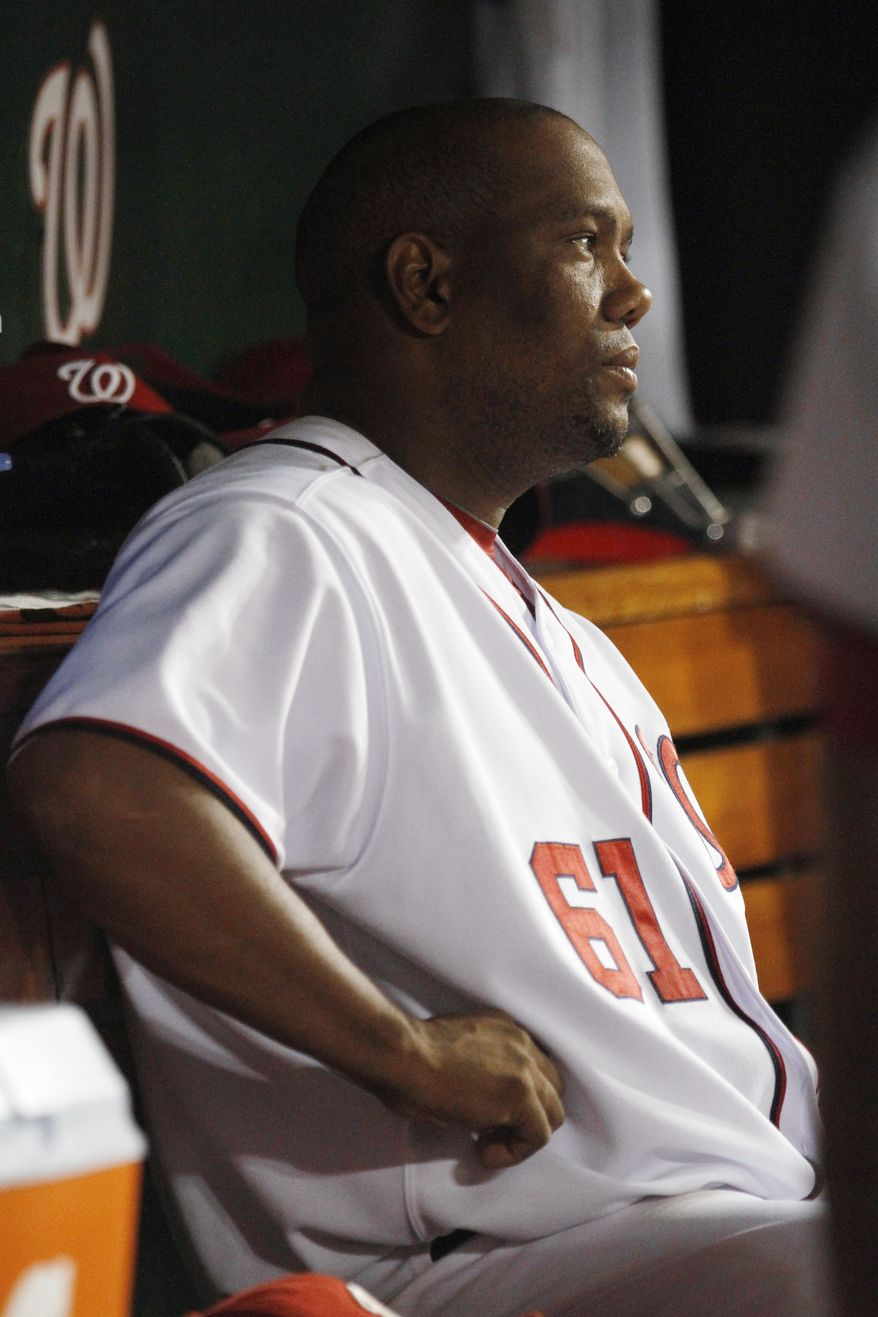 Washington Nationals starting pitcher Livan Hernandez watches the game after being pulled in the fifth inning against the Florida Marlins on Wednesday. He gave up four runs and the Marlins won 7-5. (AP Photo/Jacquelyn Martin)