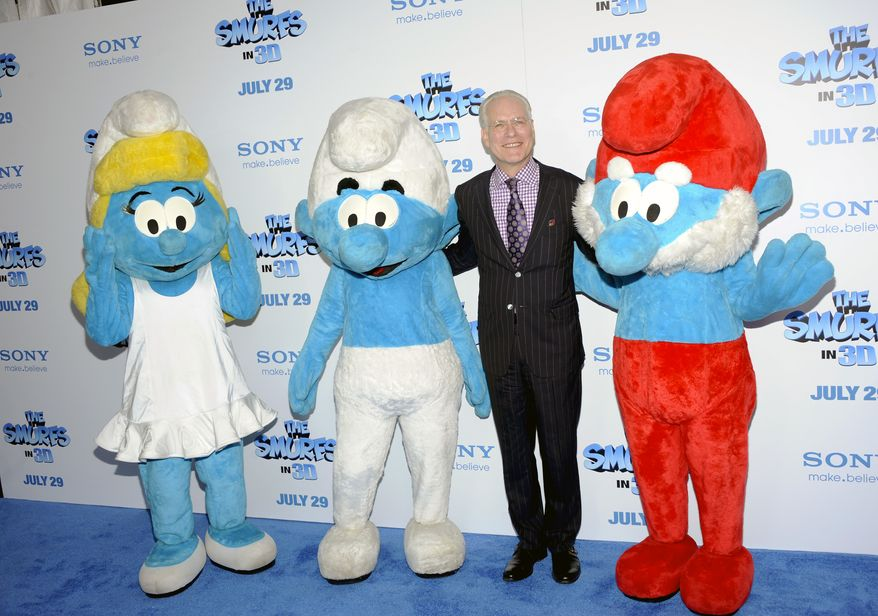 "Televsion personality Tim Gunn poses with Smurf characters at the premiere of ""The Smurfs"" at the Ziegfeld Theatre in New York on July 24, 2011. (Associated Press)"