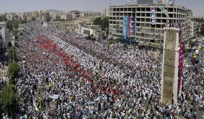 ** FILE ** In this Friday, July 22, 2011, a citizen journalism image made on a mobile phone and provided by Shaam News Network, Syrian anti-regime protesters gather during a rally in al-Assy square in the western city of Hama, Syria. Note: The Associated Press is unable to independently verify the authenticity, content, location or date of this handout photo. (AP Photo/Shaam News Network, File) (AP Photo/Shaam News Network, File)