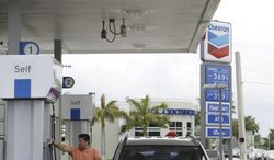 A driver fuels his car at a Chevron gas station in Miami in July 2011. (Associated Press)