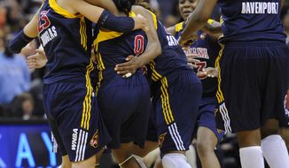 Indiana Fever's Shannon Bobbitt (0), Jessica Davenport (50), Katie Douglas (23) and others celebrate their 61-59 buzzer-beater win over the Washington Mystics on Friday. (AP Photo/Nick Wass)