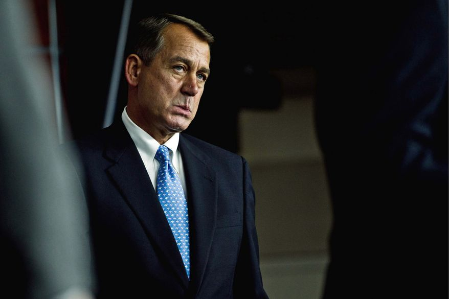 House Speaker John A. Boehner discusses the debt bill on Capitol Hill on Thursday. House Republicans' plan would cut future spending by $915 billion while instantly raising the government's borrowing authority by $900 billion. (Drew Angerer/The Washington Times)