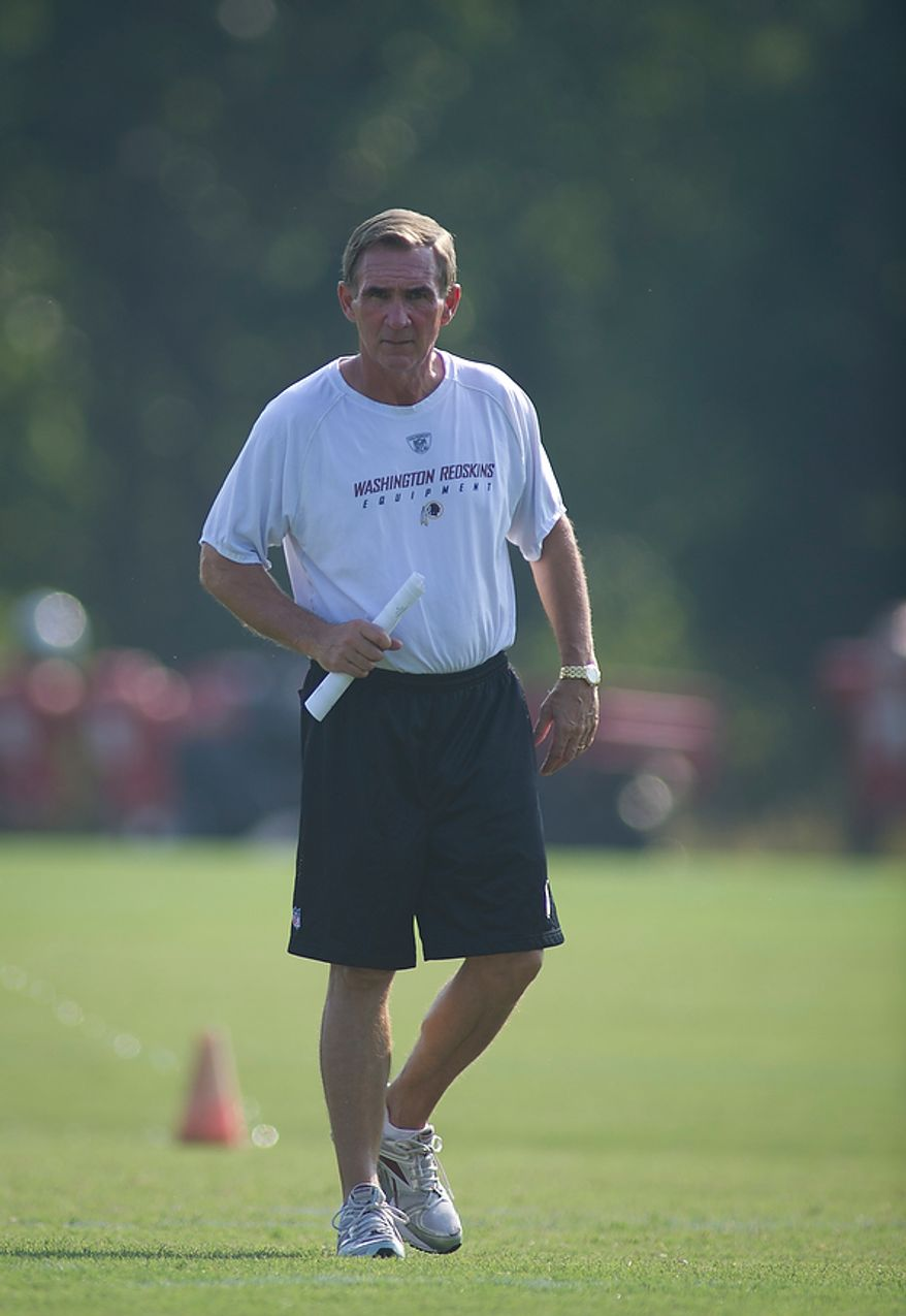 Washington Redskins Head Coach Mike Shanahan walks the practice field during the first day of training camp at Redskins Park in Ashburn, Va., Friday, July 29, 2011. (Rod Lamkey Jr./The Washington Times)