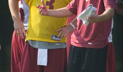 Washington Redskins Offensive Coordinator Kyle Shanahan (right) talks with quarterback John Beck (3) during the first day of training camp at Redskins Park in Ashburn, Va., Friday, July 29, 2011. (Rod Lamkey Jr./The Washington Times)