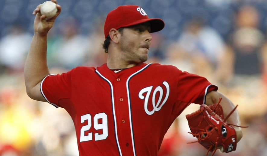 Starting in place of Jason Marquis, who was traded Saturday night, Yunesky Maya earned his first career win in the Washington Nationals' 3-0 victory over the New York Mets. (AP Photo/Luis M. Alvarez)