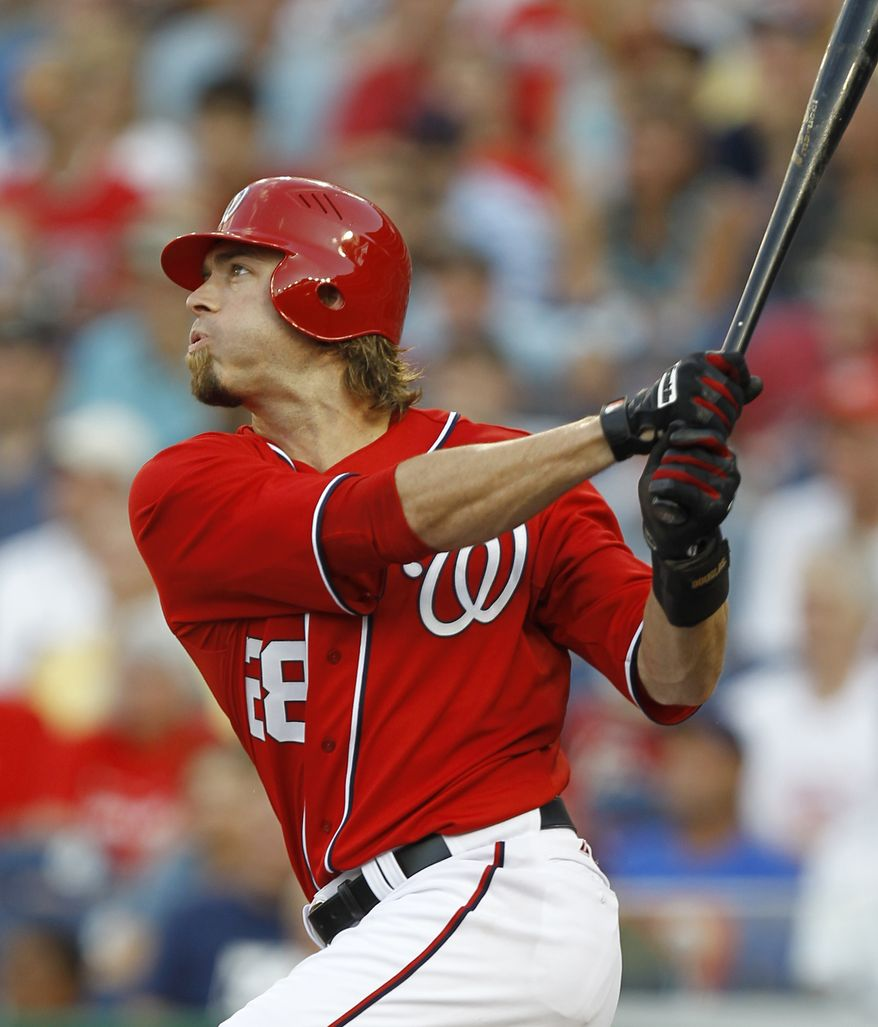 Washington Nationals' Jayson Werth follows through on a three-run home run during the first inning against the New York Mets on Saturday. The Nats won 3-0. (AP Photo/Luis M. Alvarez)
