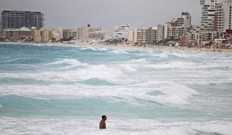 "Gaviota Azul beach in Cancun, Mexico, is one of the attractions the country hopes will lift it from the world's 10th-most-popular tourism destination to a top-five spot by 2018. ""We believe that we can do better,"" said Gloria Guevara, Mexico's tourism secretary. (Associated Press)"