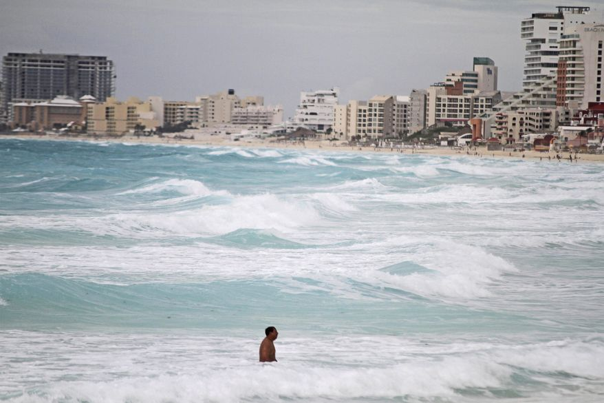 """Gaviota Azul beach in Cancun, Mexico, is one of the attractions the country hopes will lift it from the world's 10th-most-popular tourism destination to a top-five spot by 2018. """"We believe that we can do better,"""" said Gloria Guevara, Mexico's tourism secretary. (Associated Press)"""