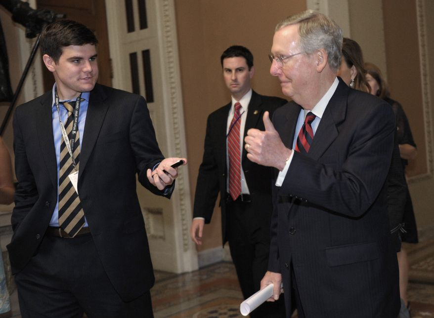 Senate Minority Leader Mitch McConnell, Kentucky Republican, gives a thumbs up when asked about a deal an the debt ceiling as he heads to the Senate floor on Capitol Hill in Washington, Sunday, July 31, 2011. (AP Photo/Susan Walsh)