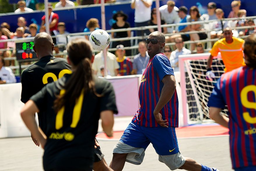 Kobe Bryant moves the ball downfield during the Mia Hamm and Nomar Garciaparra Celebrity Soccer Challenge, at Washington Kastles Stadium, in Washington, D.C., Sunday, July 31, 2011. (Drew Angerer/The Washington Times)