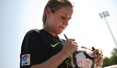 Heather O'Reilly, member of the U.S. Women's National Team, signs autographs during the Mia Hamm and Nomar Garciaparra Celebrity Soccer Challenge, at Washington Kastles Stadium, in Washington, D.C., Sunday, July 31, 2011. (Drew Angerer/The Washington Times)