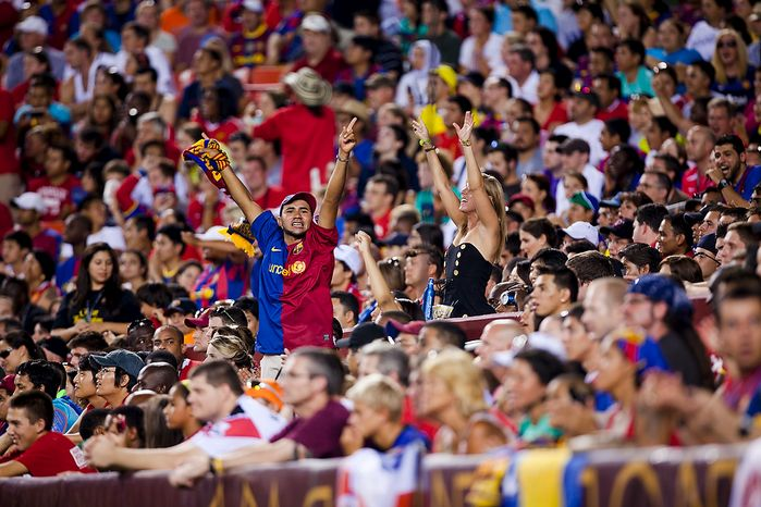 FC Barcelona fans try to pump up the crowd during the 2011 Herbalife World Football Challenge match between Manchester United and FC Barcelona at FedEx Field in Landover, Md. on Saturday, July 30, 2011. (Pratik Shah/The Washington Times)
