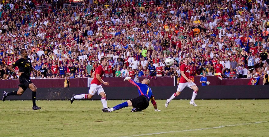 Manchester United forward Michael Owen scores the game-winning goal over FC Barcelona goalkeeper Victor Valdés during the 2011 Herbalife World Football Challenge match between Manchester United and FC Barcelona at FedEx Field in Landover, Md. on Saturday, July 30, 2011. (Pratik Shah/The Washington Times)