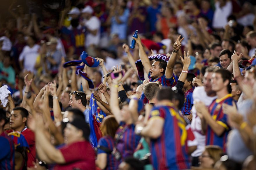 FC Barcelona fans celebrate their team's game-tying goal during the 2011 Herbalife World Football Challenge match between Manchester United and FC Barcelona at FedEx Field in Landover, Md. on Saturday, July 30, 2011. (Pratik Shah/The Washington Times)