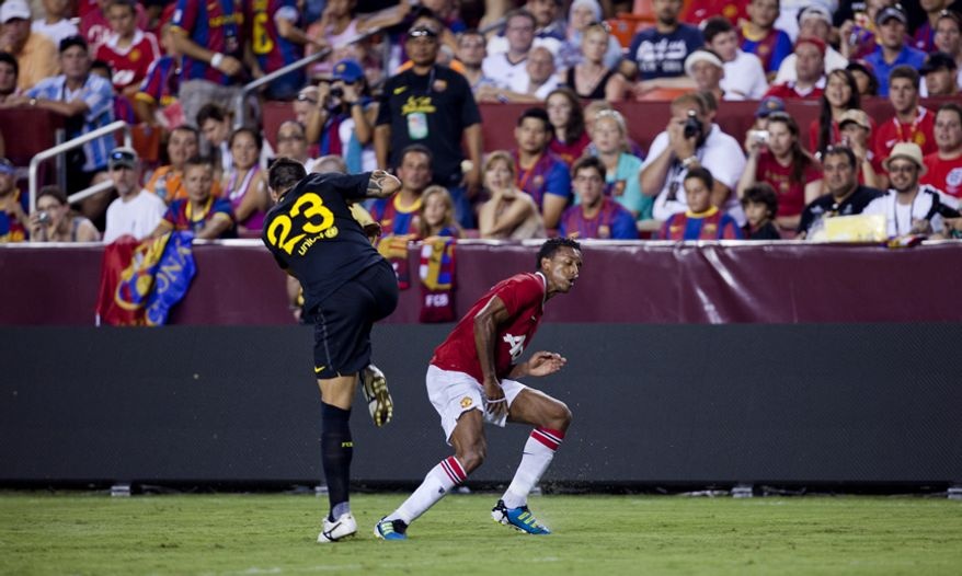 Manchester United midfielder Nani and FC Barcelona defender Armando avoid a collison during the 2011 Herbalife World Football Challenge match between Manchester United and FC Barcelona at FedEx Field in Landover, Md. on Saturday, July 30, 2011. (Pratik Shah/The Washington Times)